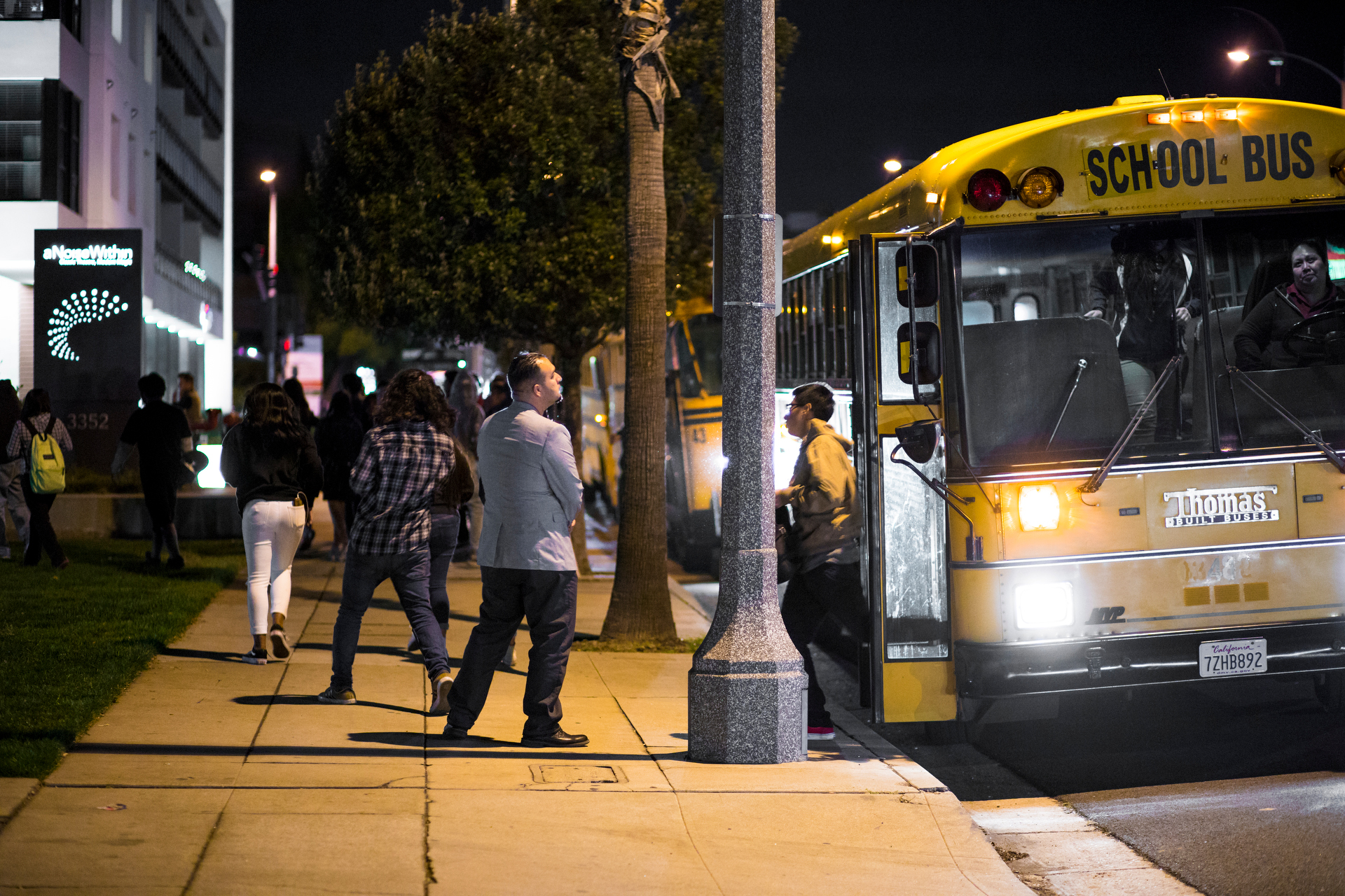 A bus drops off people in front of A Noise Within.