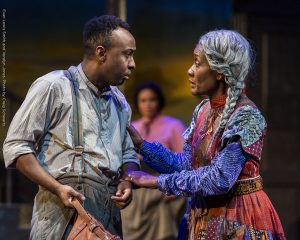 Aunt Ester holds onto Citizen Barlow's arm as he looks for guidance in Gem of the Ocean.